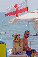 Sunny Beach, Nesebar, Bulgaria..An English expatriate and his dog at Sunny Beach, the largest holiday resort in the Balkans, and a popular destination for cheap foreign package tours.