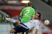 FUSSBALL   1. BUNDESLIGA   SAISON 2011/2012    5. SPIELTAG VfL Wolfsburg - FC Schalke 04                                  11.09.2011 Christian FUCHS (vorn, Schalke) gegen Patrick OCHS (hinten, Wolfsburg)