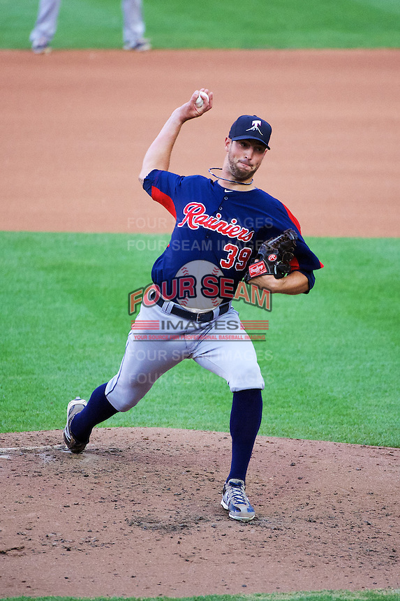 Forrest Snow (39) of the Tacoma Rainiers delivers a pitch to the plate against the Salt Lake Bees in Pacific Coast League action at Smith's Ballpark on July 9, 2014 in Salt Lake City, Utah.  (Stephen Smith/Four Seam Images)