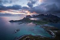 MIdnight sun view over coastal landscape from summit of Offersøykammen mountain peak, Vestvågøy, Lofoten Islands, Norway