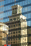 Clock reflections in glass. Down town buildings, Vancouver, British Colombia, Canada. British Columbia, Canada