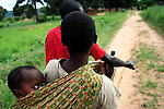 DUBIE, DEMOCRATIC REPUBLIC OF CONGO DECEMBER 5: A refugee family arrives by bicycle on December 5, 2005 in Dubie, Katanga Province in Congo, DRC. They have been fleeing fighting between the Congolese army and Mai-Mai rebels in Eastern Congo, and thousands of them arrived in Dubie in December 2005. They are some of the victims of the civil war that started in 1996. Many people have moved from area to area the last years trying to find safety. About four million people have died in Congo since 1996, making it the deadliest humanitarian crisis in recent memory. Most of people have died of preventable diseases such as malaria, measles, diarrhea, respiratory infections and malnutrition. The health system has collapsed and very few people have access to healthcare. Congo is planning to hold general elections by June 2006, the first democratic elections in forty years..(Photo by Per-Anders Pettersson/Getty Images).