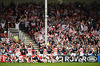 Japan supporters in the crowd celebrate a try. Rugby World Cup Pool B match between Scotland and Japan on September 23, 2015 at Kingsholm Stadium in Gloucester, England. Photo by: Patrick Khachfe / Onside Images