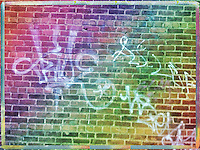 Graffiti on a brick wall, downtown Asheville, NC, iPhone photo from the archive at bcpix.com. (Photo by Brian Cleary/www.bcpix.com)
