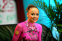 """Marina Shpekht of Russia smiles from """"kiss & cry"""" during senior All-Around at 2007 World Cup Kiev, """"Deriugina Cup"""" in Kiev, Ukraine on March 17, 2007."""