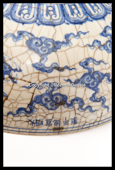 BNPS.co.uk (01202 558833)<br /> Pic: ReemanDansie/BNPS<br /> <br /> ***Please Use Full Byline***<br /> <br /> A Chinese bowl sold for &pound;108,000 at auction. <br /> <br /> A battered bowl that was until recently the favourite sleeping place for a pet cat has sold for 108,000 pounds.<br /> <br /> The 12inch wide bowl has chips, cracks and staples in from where it was once repaired after being broken in two.<br /> <br /> Its owners kept the Chinese piece on a chest of drawers in their hallway and it was used as a bizarre bed for their moggy.<br /> <br /> Auctioneers gave it a 200 pounds estimate but were stunned when it went under the hammer for 90,000 pounds, or 108,000 pounds including fees.
