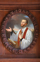 Painting of St Francis Xavier, 1506-52, founder of the Society of Jesus or Jesuit Order, preaching, by Jean Helart, 1618-85, French painter, in a carved wooden garland frame set in the wooden panelling of the refectory of the Ancien College des Jesuites or Former Jesuit College in Reims, Marne, Champagne-Ardenne, France. The College was built 1619-78 and is now the Euro-American campus of Sciences Po, or the Institut d'Etudes politiques de Paris, and the FRAC Champagne-Ardenne. It is listed as a historic monument. Picture by Manuel Cohen