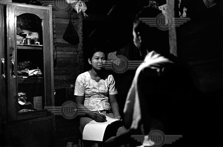 Daw Khin Khin Maw, who is HIV positive, counsels other people with the virus, with the support of an aid organisation in Rangoon.