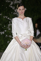 Model walks runway in a Chrissy wedding dresses by Carolina Herrera, for the Carolina Herrera Bridal Spring 2012 runway show.