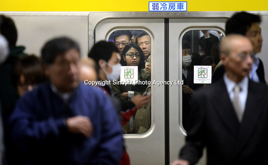 Passengers on a platform and packed on a train in Shinjuku Station, Tokyo, Japan. With up to 4 million passengers passing through it every day, Shinjuku station, Tokyo, Japan, is the busiest train station in the world. The station was used by an average of 3.64 million people per day.  That&rsquo;s 1.3 billion a year.  Or a fifth of humanity. Shinjuku has 36 platforms, and connects 12 different subway and railway lines.  Morning rush hour is pandemonium with all trains 200% full. <br /> <br /> Photo by Richard jones / sinopix