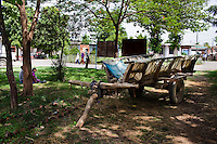 An ox cart, similar to one that Pramila Tharu had given birth in on her way to the hospital, parked in the Bardia District Hospital compound in Bardia, Western Nepal, on 29th June 2012. In Bardia, StC works with the district health office to build the capacity of female community health workers who are on the frontline of health service provision like ante-natal and post-natal care, and working together against child marriage and teenage pregnancy especially in rural areas. Photo by Suzanne Lee for Save The Children UK