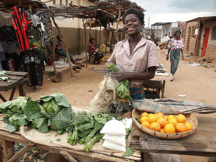 Woman selling cabbage and sugar at the local market.