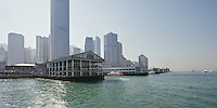 The 4th incarnation of the Star Ferry pier in Central, Hong Kong, built on reclaimed land and opened in November 2006. Towering behind is the International Finance Centre Tower 2 (2IFC)