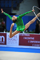 Viktoriya Mazur of Ukraine performs cossack leap with hoop at 2010 Pesaro World Cup on August 27, 2010 at Pesaro, Italy.  Photo by Tom Theobald.