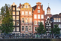 Bicycles and traditional Dutch architecture of canalside buildings in Prinsengracht, Amsterdam, Holland