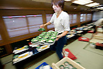"""Staffer Sachiko Yoshino sets the tables in preparation for an evening aboard a """"Yakata-bune"""" pleasure boat run by the Yasuda family in Tokyo, Japan on 31 August  2010. .Photographer: Robert Gilhooly"""