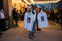 NEW YORK APRIL 21:Man selling Prince's T-shirt s at a makeshift memorial place created outside Apollo Theatre in Harlem, New York City, Friday, April 21, 2016. The pop star die a few hours ago at the age of 57.Photo by VIEWpress/Maite H. Mateo