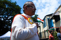A man sings the Indian hymn during the annual Indian independence day parade in New Jersey,  August 11, 2013. Photo by Eduardo Munoz Alvarez / VIEWpress.
