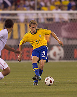 Brazil midfielder Lucas (5) passes the ball. Brazil  defeated the US men's national team, 2-0, in a friendly at Meadowlands Stadium on August 10, 2010.
