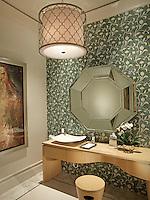 The formal powder bath has mosaic tiled walls with a modern vanity