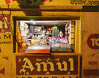 Forty-year-old Mrs. Tara with her son, eighteen-year-old Rahul, in their small grocery shop, which opens from 7am to 11pm. Mrs. Tara hopes that her son will take over the shop in the future.