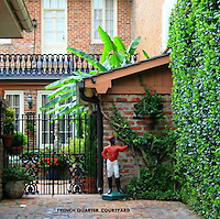 brick and wrought iron french quarter patio
