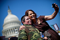 Rep. Michele Bachmann (R-MN) snaps a picture with Nick Cifolelli, 13, of Elkton, Md., at a Tea Party rally on Capitol Hill on Wednesday, April 6, 2011 in Washington. (Photo by Jay Westcott/Politico)