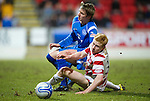 St Johnstone v Hamilton Accies....02.02.11  .Ziggy Gordon tackles Arvydas Novikovas.Picture by Graeme Hart..Copyright Perthshire Picture Agency.Tel: 01738 623350  Mobile: 07990 594431