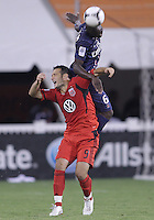 WASHINGTON, DC - July 28, 2012:  Hamdi Salihi (9) of DC United loses a header to Zoumana Camara (6) of PSG (Paris Saint-Germain) in an international friendly match at RFK Stadium in Washington DC on July 28. The game ended in a 1-1 tie.