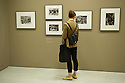 London, UK. 12.09.2012. EVERYTHING WAS MOVING, the changing world of the 60s and 70s captured by international photographers, opens in the Barbican art gallery. Picture shows a visitor looking at the work of Ernest Cole. Photo credit: Jane Hobson.