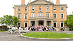 With family and friends gathered on the steps of Sleepy Hollow Country Club, the newly weds ride off in a horse drawn carriage.