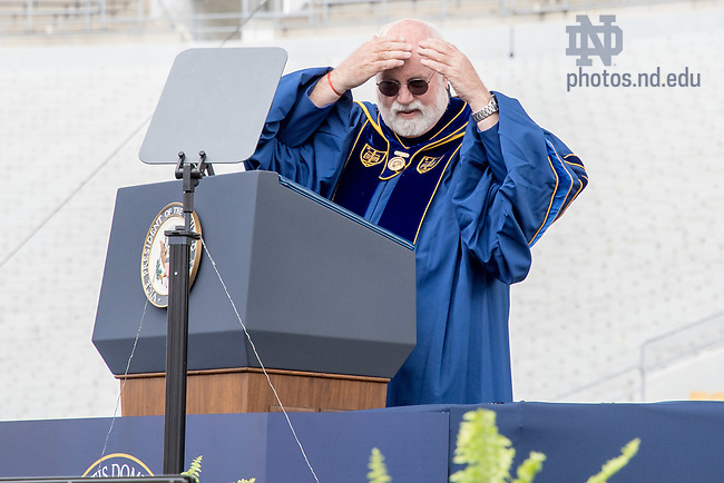 """May 21, 2017; """"Wow. I had no idea I was bald,"""" joked Rev. Gregory J. Boyle, S.J. as he began his Laetare Medal address at Commencement 2017. (Photo by Matt Cashore/University of Notre Dame)"""