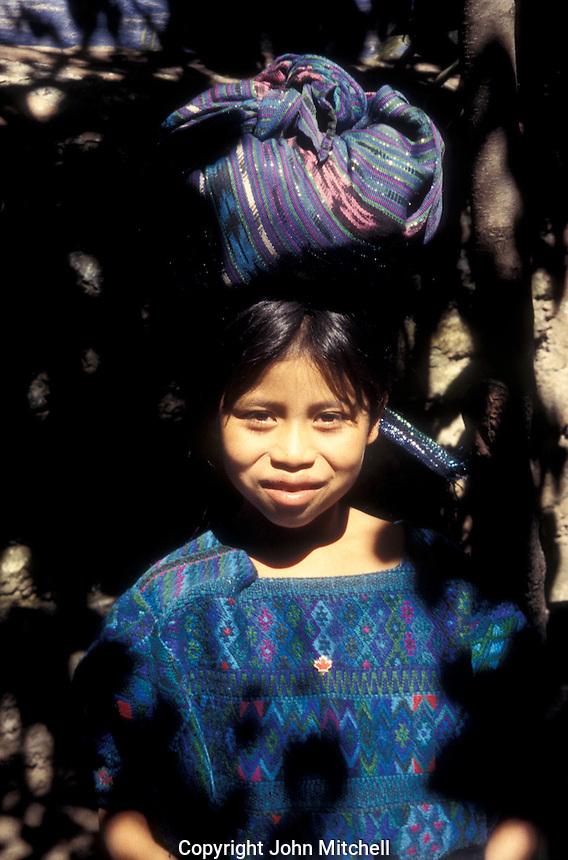 Young Maya girl wearing traditional Mayan clothing or traje, Antigua, Guatemala