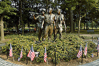 Jun 14, 2004; Washington, CA, USA; Scenic exterior view of The Three Servicemen bronze statue at the Vietnam Veterans War Memorial inside Constitution Gardens.  A place to see when traveling to Washington.