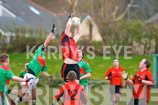 Paudie Cliffor (Fossa) rises high above Paul Collins (Beale) to gather the ball from a kick-out when the sides clashed last Saturday evening at Fossa GAA ground.