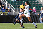 05 December 2010: Notre Dame's Jessica Schuveiller (12) clears the ball from Stanford's Christen Press (in white). The Notre Dame University Fighting Irish defeated the Stanford University Cardinal 1-0 at WakeMed Stadium in Cary, North Carolina in the 2010 NCAA Women's College Cup Championship Game.