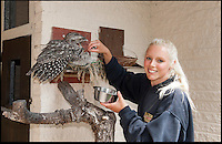 BNPS.co.uk (01202) 558833<br /> Picture: Peter Willows<br /> <br /> Senior keeper Stephanie Cox with Tawny Frogmouth dad Gerben and chick Willow<br /> <br /> These old birds are thought to be the oldest parents in the world with their combined ages of a staggering 372 years. The two Tawny Frogmouth birds from Australia have recently hatched their eighth chick despite their impressive ages. Experts believe the oldest of the breed in captivity was 30, which means that the plucky male bird named Gerben has already beaten the previous record with his impressive 33-years, which translates to an incredible 198 in human years. Tawny Frogmouths - Podargus strigoides in Latin - are only expected to live for an average of up to 14 years in the wild. The duo live at Paultons Park near Romsey in Hampshire with their nine-week-old chick Willow, who experts hope will follow in her parents' footsteps.