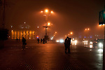 A couple hug on October Square in Minsk during an early evening fog on Nov. 7, 2009.