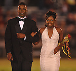 Senior maid Mykira Buford is escorted by Demetrious Bogard at Lafayette High vs. Lewisburg in Homecoming football action in Oxford, Miss. on Friday, September 30, 2011.