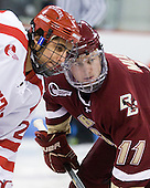 Sahir Gill (BU - 28) and Pat Mullane (BC - 11) take the opening face-off. - The visiting Boston College Eagles defeated the Boston University Terriers 3-2 to sweep their Hockey East series on Friday, January 21, 2011, at Agganis Arena in Boston, Massachusetts.