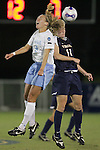 9 November 2007: North Carolina's Whitney Engen (9) and Virginia's Becky Sauerbrunn (11) challenge for a header. The University of North Carolina tied the University of Virginia 1-1 at the Disney Wide World of Sports complex in Orlando, FL in an Atlantic Coast Conference tournament semifinal match.  UNC advanced to the finals on penalty kicks, 4-2.