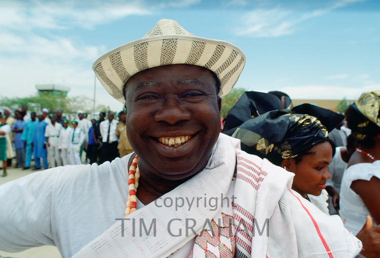 A happyl, smiling Nigerian man waiting for friends at Maiduguri Airport in Nigeria