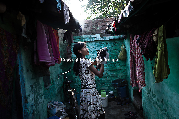 A young girl from the Devanga caste seen in the narrow lanes of Mahesh, Hooghly in West Bengal, India.  Photo: Sanjit Das/Panos for The Wall Street Journal. Slug: ICASTE