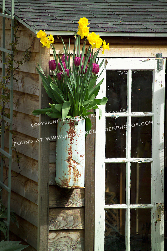 decorative wall vase filled with spring flowers