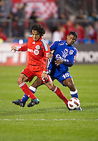 19 October 2010: Toronto FC Oscar Cordon #26 battles with Arabe Unido Luis Jaramillo #18 during a CONCACAF game between Arabe Unido and Toronto FC at BMO Field in Toronto..Toronto FC won 1-0..