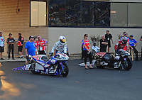 Jun. 30, 2012; Joliet, IL, USA: NHRA pro stock motorcycle rider Hector Arana Jr (left) pushes up to the burnout box alongside his father Hector Arana Sr during qualifying for the Route 66 Nationals at Route 66 Raceway. Mandatory Credit: Mark J. Rebilas-