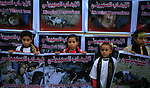 Palestinian girls hold posters of Palestinians killed during the last Israeli war on Gaza, during a rally organized by Islamic Jihad marking the first anniversary of Gaza war, in Gaza city, Tuesday, Dec. 31, 2009. Israel launched the three-week long offensive on Dec. 27, 2008, to end years of rocket fire from Gaza toward Israeli border towns. About 1,400 Palestinians were killed, including hundreds of civilians, along with 13 Israelis. Photo by Mohammed Othman