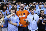 26 January 2015: A Syracuse fan watches the game from the front row of the UNC student section. The University of North Carolina Tar Heels played the Syracuse University Orange in an NCAA Division I Men's basketball game at the Dean E. Smith Center in Chapel Hill, North Carolina. UNC won the game 93-83.
