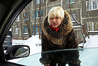 A prostitute solicits clients, through the window of a car, on a snowy street in Murmansk, the world's largest Arctic city. /Felix Features