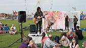 "Zee Gachette, musician (www.zstarmusic.com), performing at ""Showtime"", part of the London 2012 Festival of Arts to celebrate the London Olympics.  A family fun spectacle including dance, painting, music, acrobatics and some large mobile dynosaurs walking amongst the crowd.  On Blackheath Common, Saturday August 4th and funded by the Mayor of London and Arts Council England."